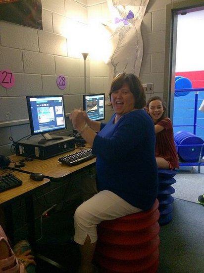 Mrs. Sullivan enjoys an ErgoSeat in her classroom.