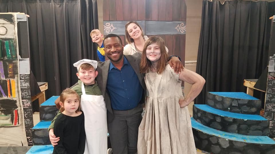 Mr Wright with students after the play