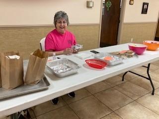 Patti helps to serve refreshments