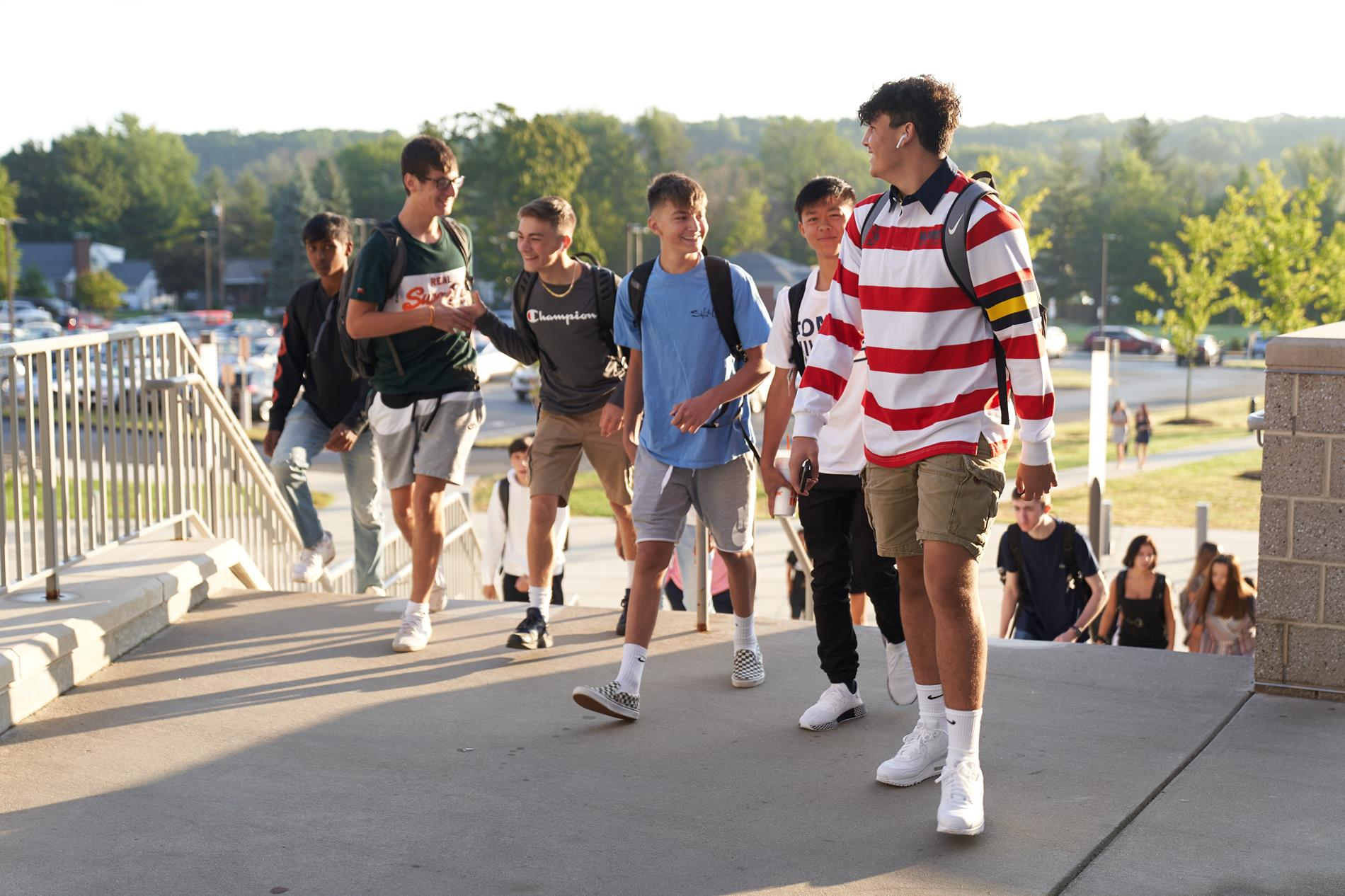 rocky hill high school students walking up the main entrance steps