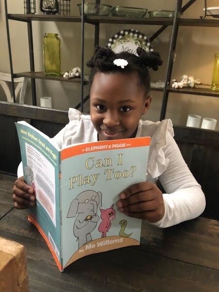 Ava enoying her book!