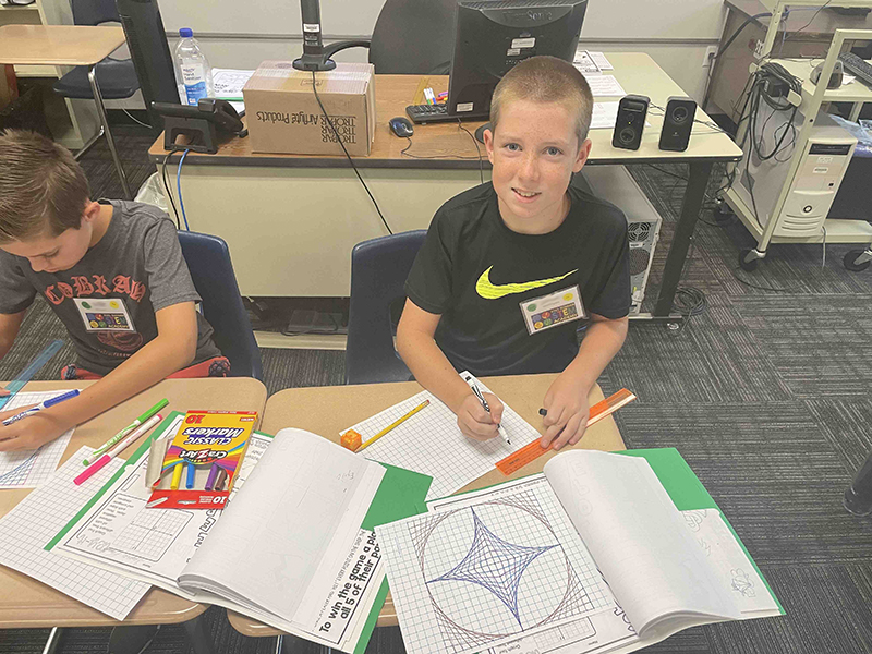 boys work on project at STEM Academy