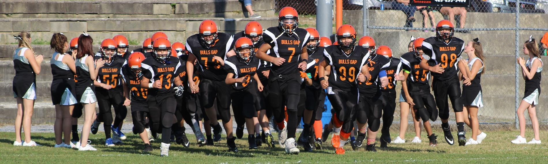 football team taking the field