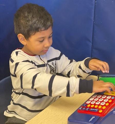 boy on cash register