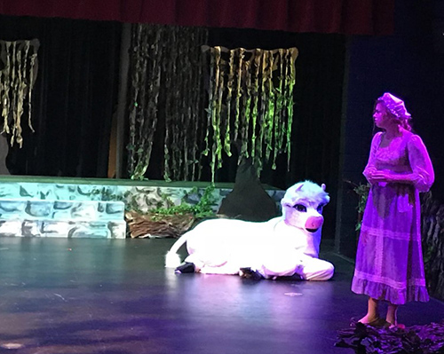 Student performs in a play
