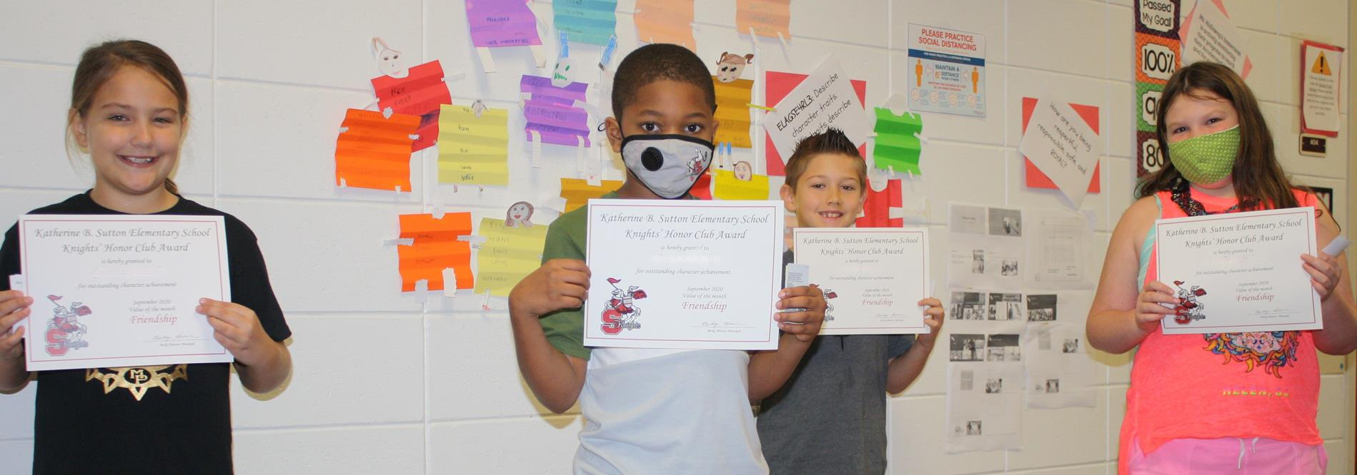 Knights Honor club members show off their certificates.