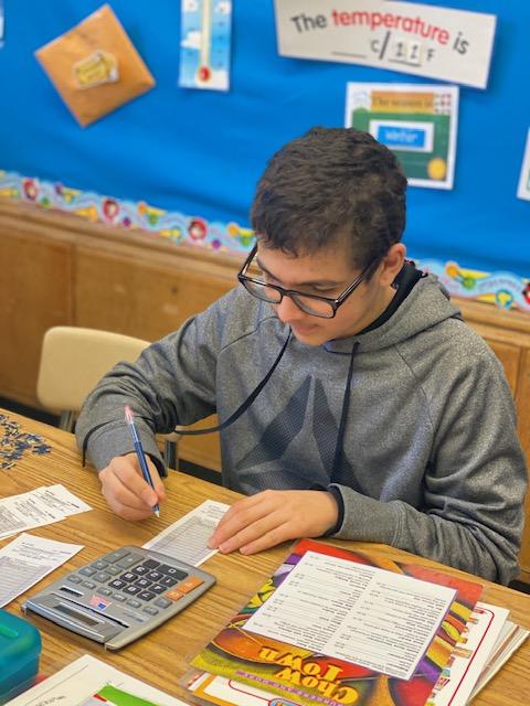 boy doing school work