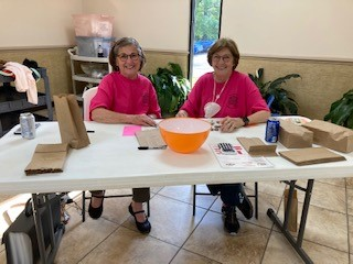 Ann and Joan Waiting to Serve You
