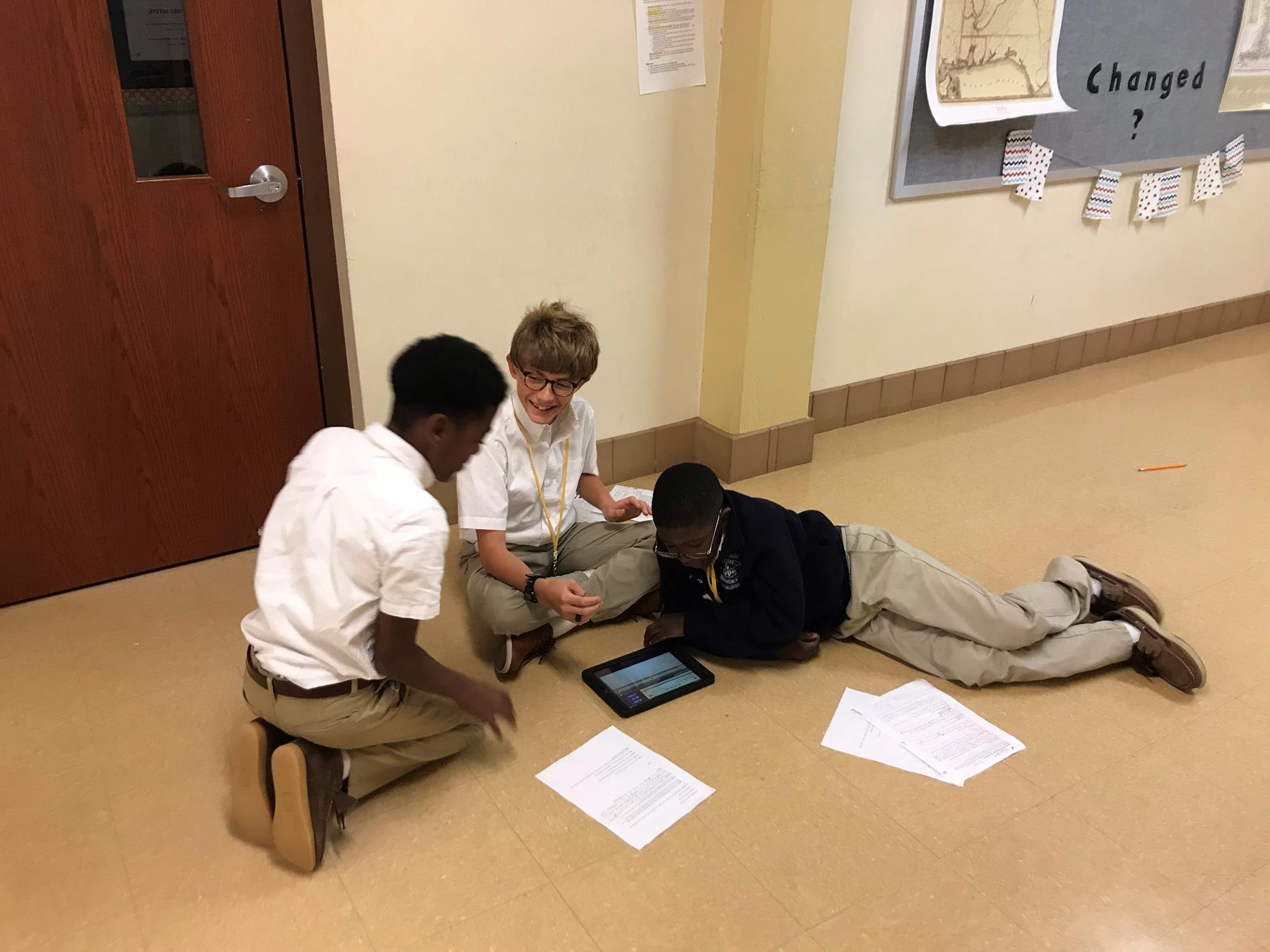 Students recording their podcast about the 1st quarter novel, as a part of their final project.