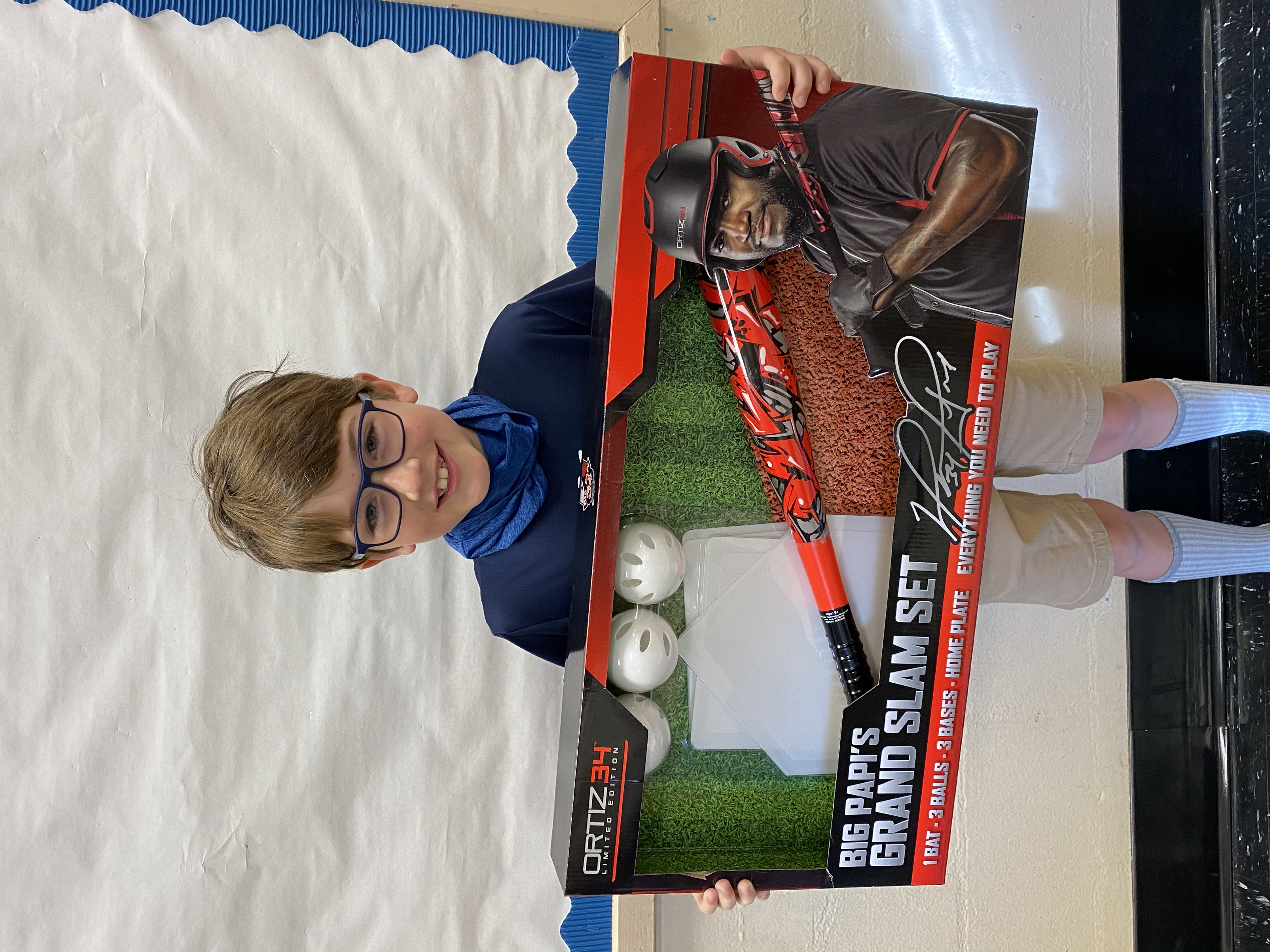 A student holding their Big Papi's Grand Slam Set they won.