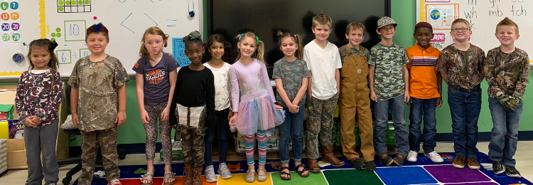 Students participating in Camo / Wacky hair Day