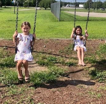 Girls on swings