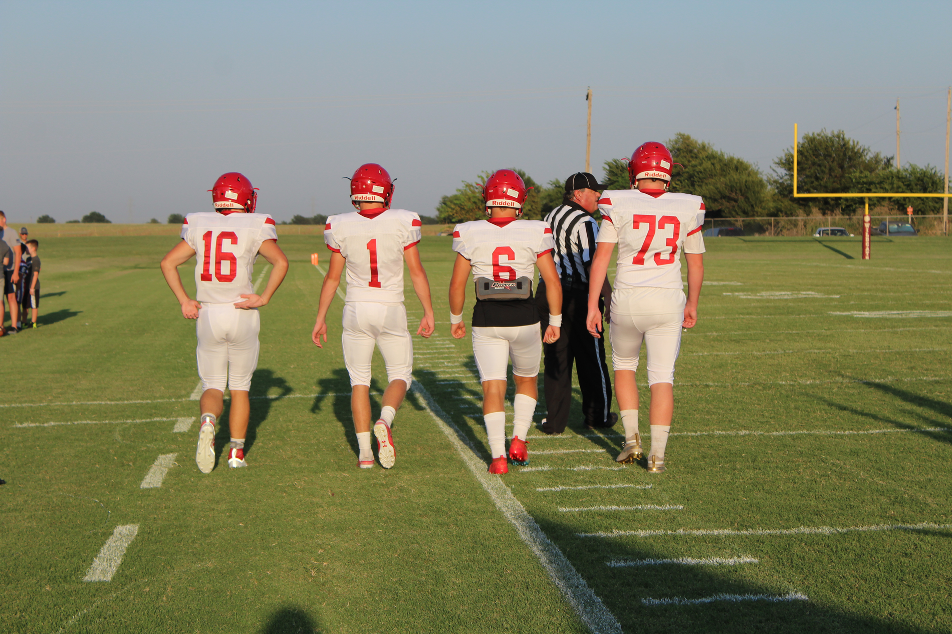 football captains walking on the field