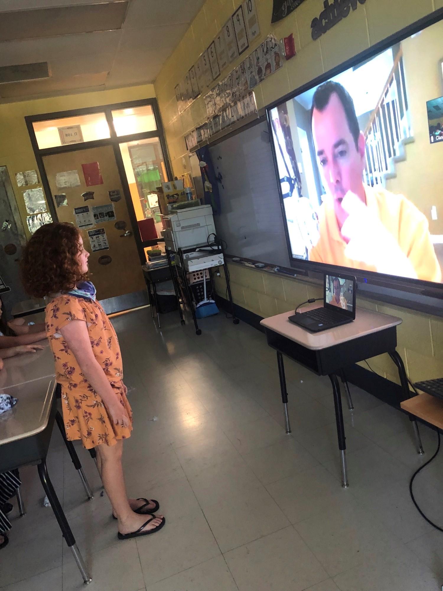 Washburn student speaks with Ken Weathers via ZOOM.
