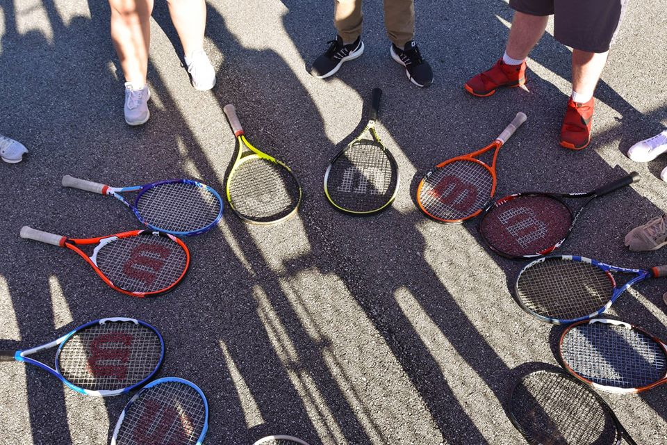 Tennis Rackets Lying on the Ground
