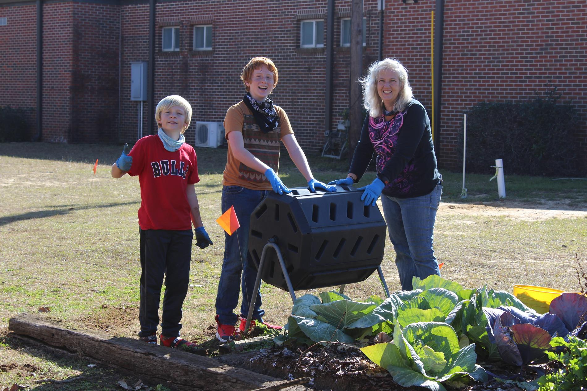 students working in the garden