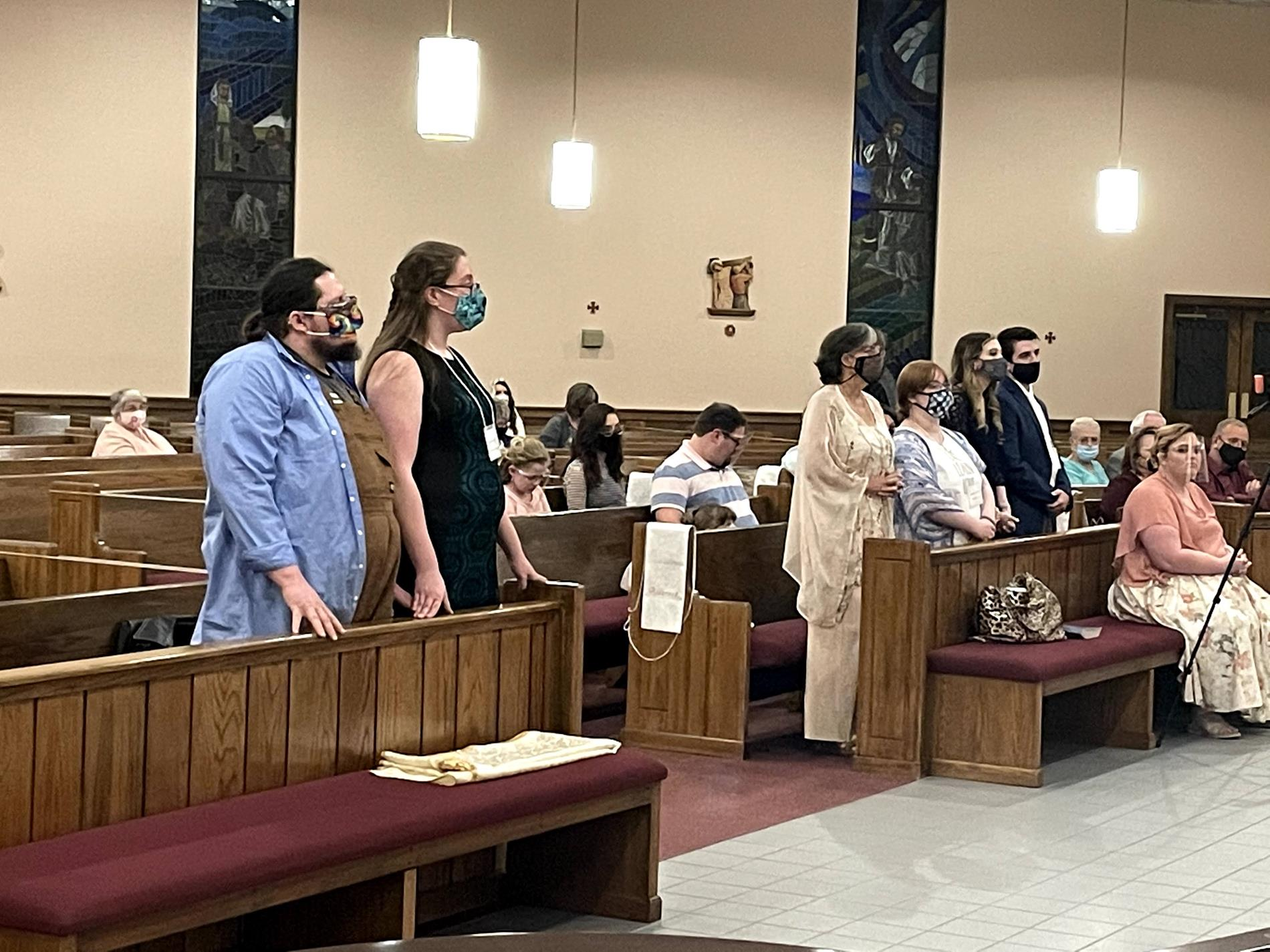 Candidates stand for beginning of the celebration of Baptism