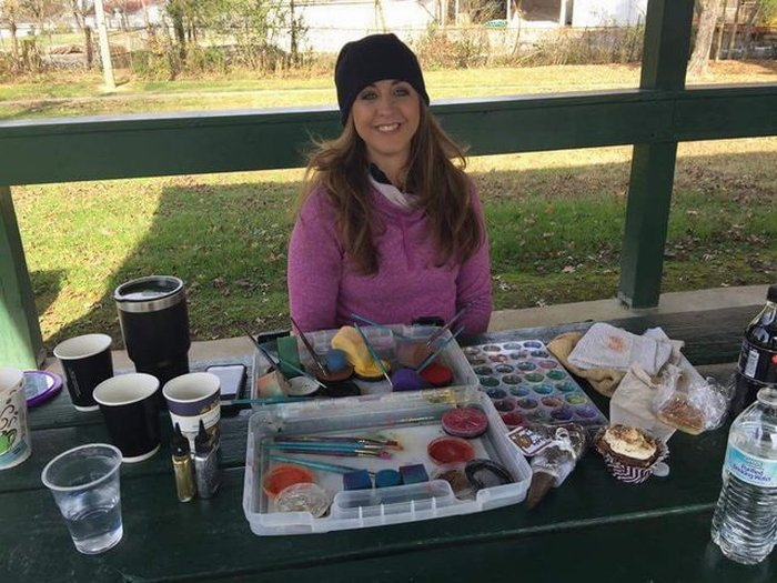 April and her face painting table