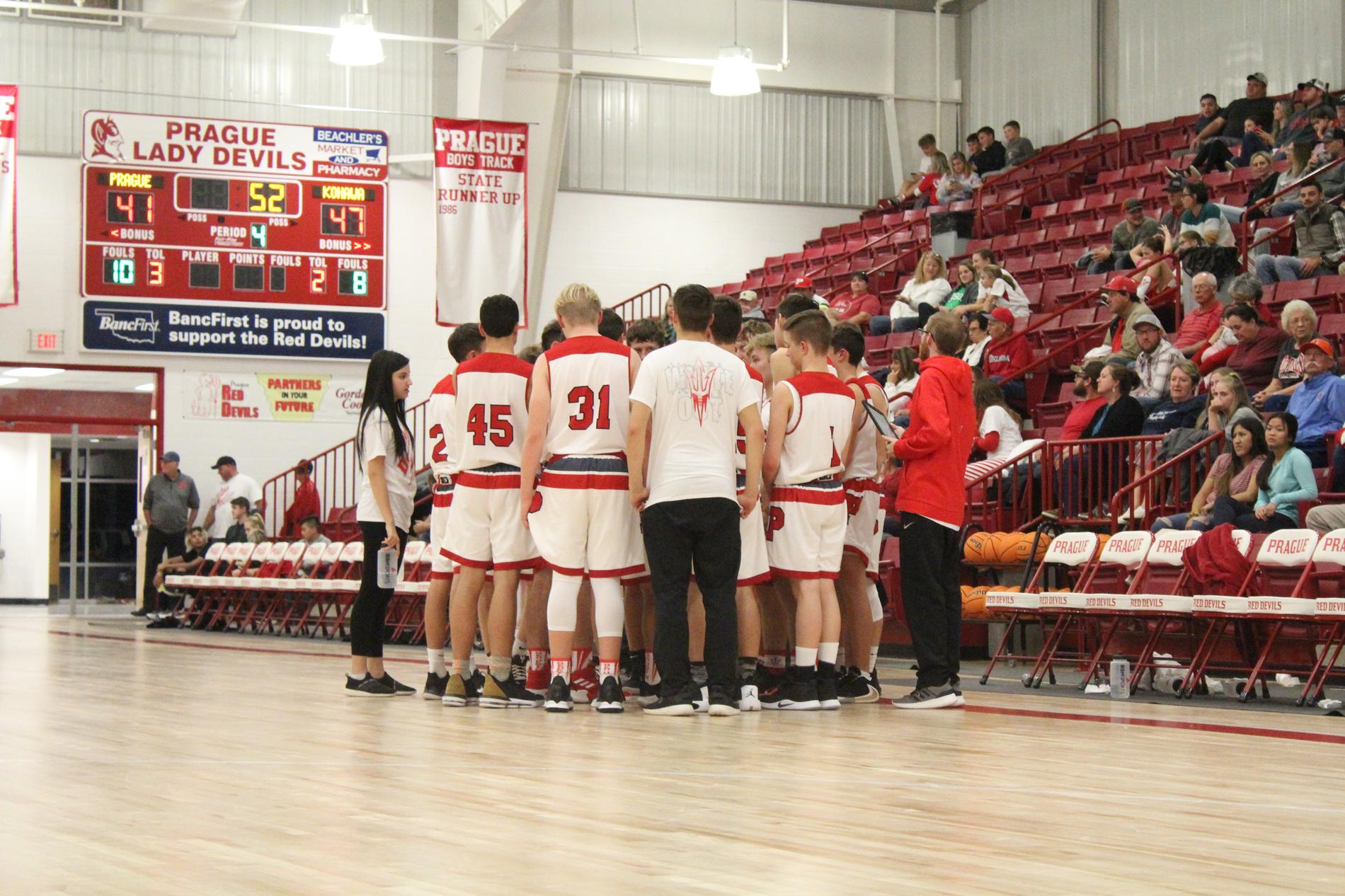 Boys basketball in huddle