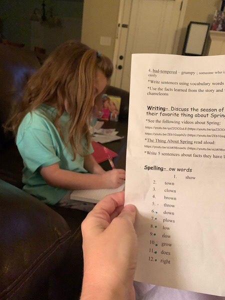Kadence taking her at-home spelling test.
