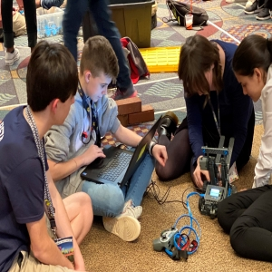 beta cats robotics team at convention