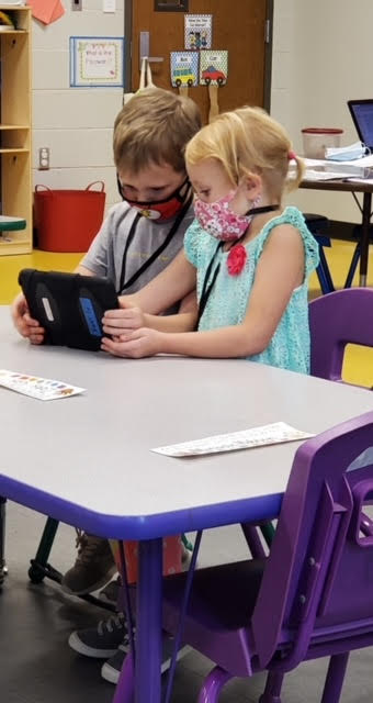 These sweet kids love to share the love of learning on their classroom iPad.