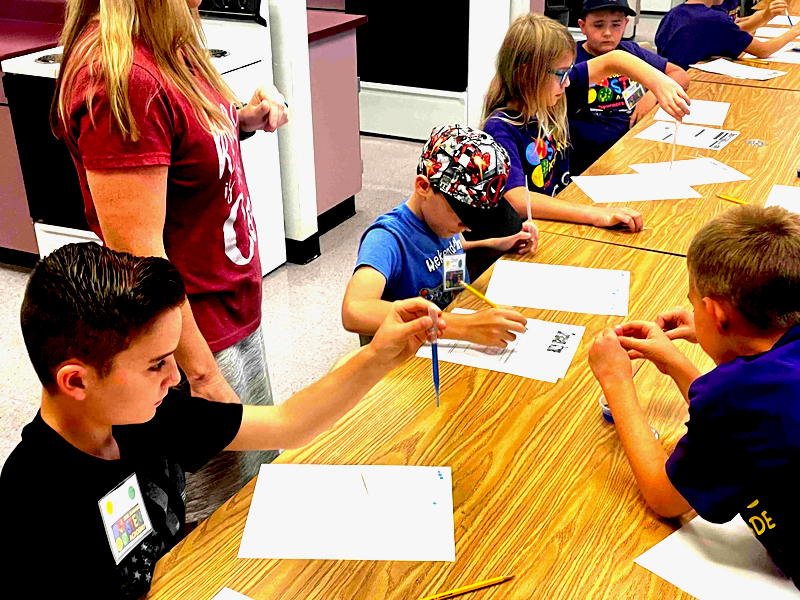 students work on project at STEM Academy