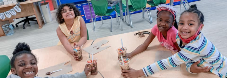 Students holding dirt cake in a cup