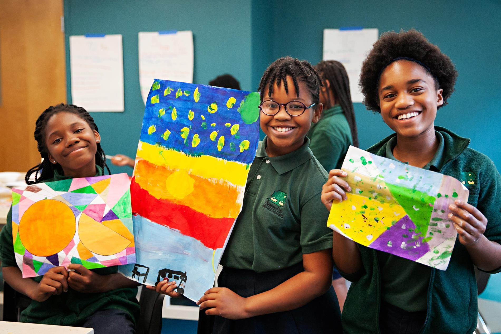 female students with art projects