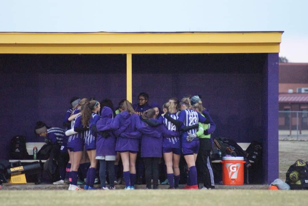 Girls huddle