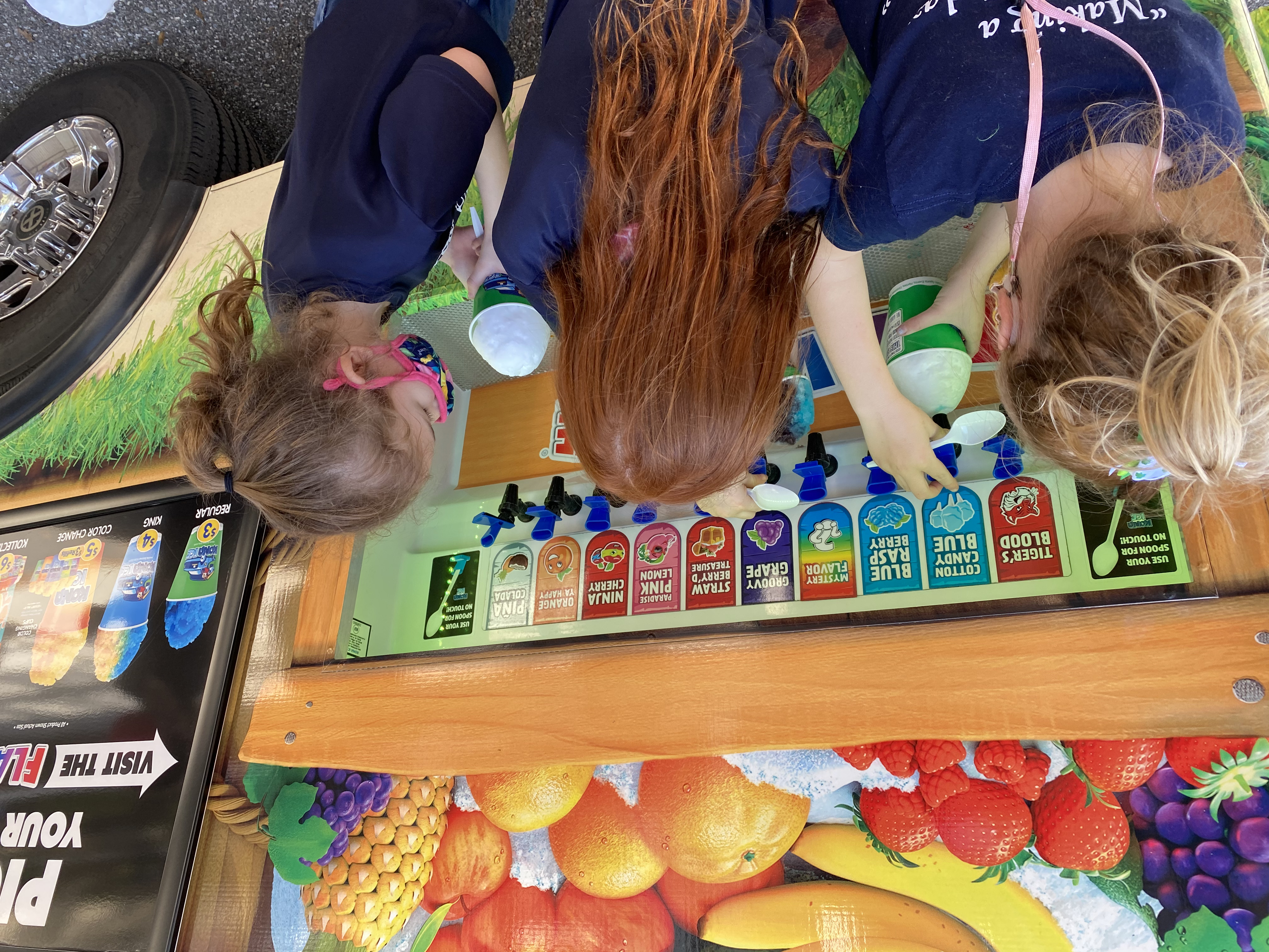Students adding flavors to their Kona Ice