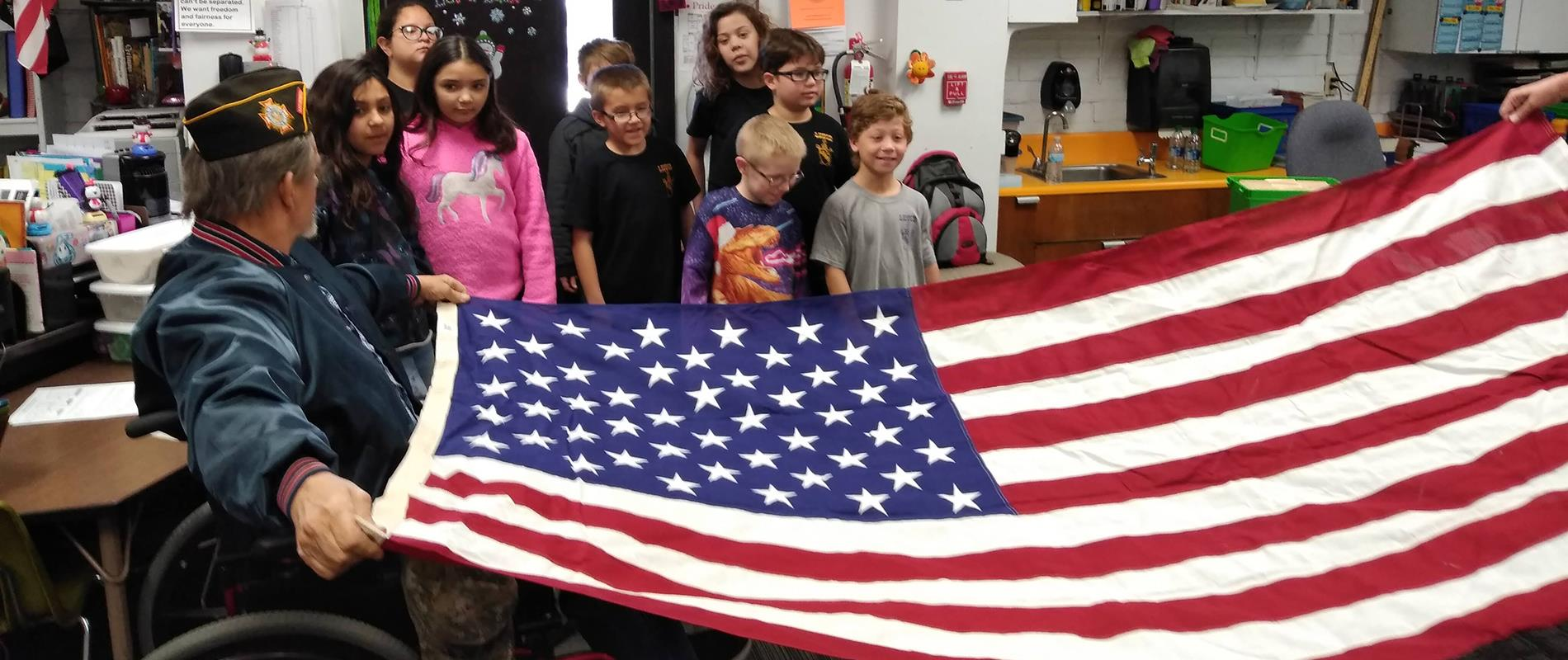 picture of students learning to fold a flag