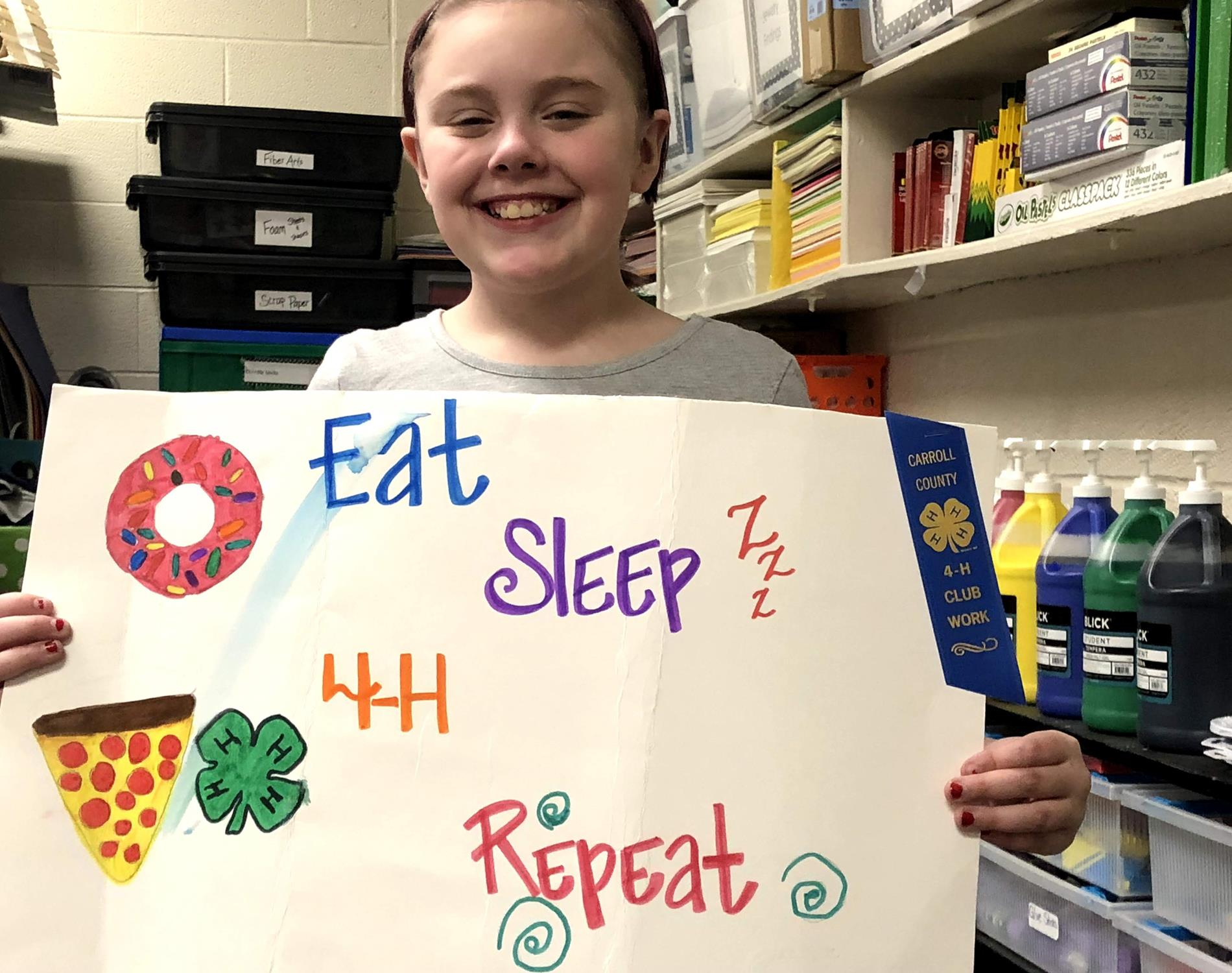 Student with 4h poster