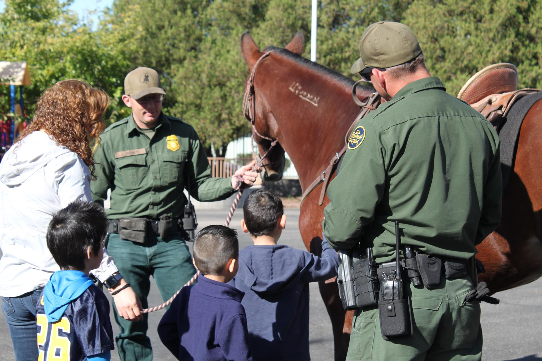 Students with a horse and Border Patrol
