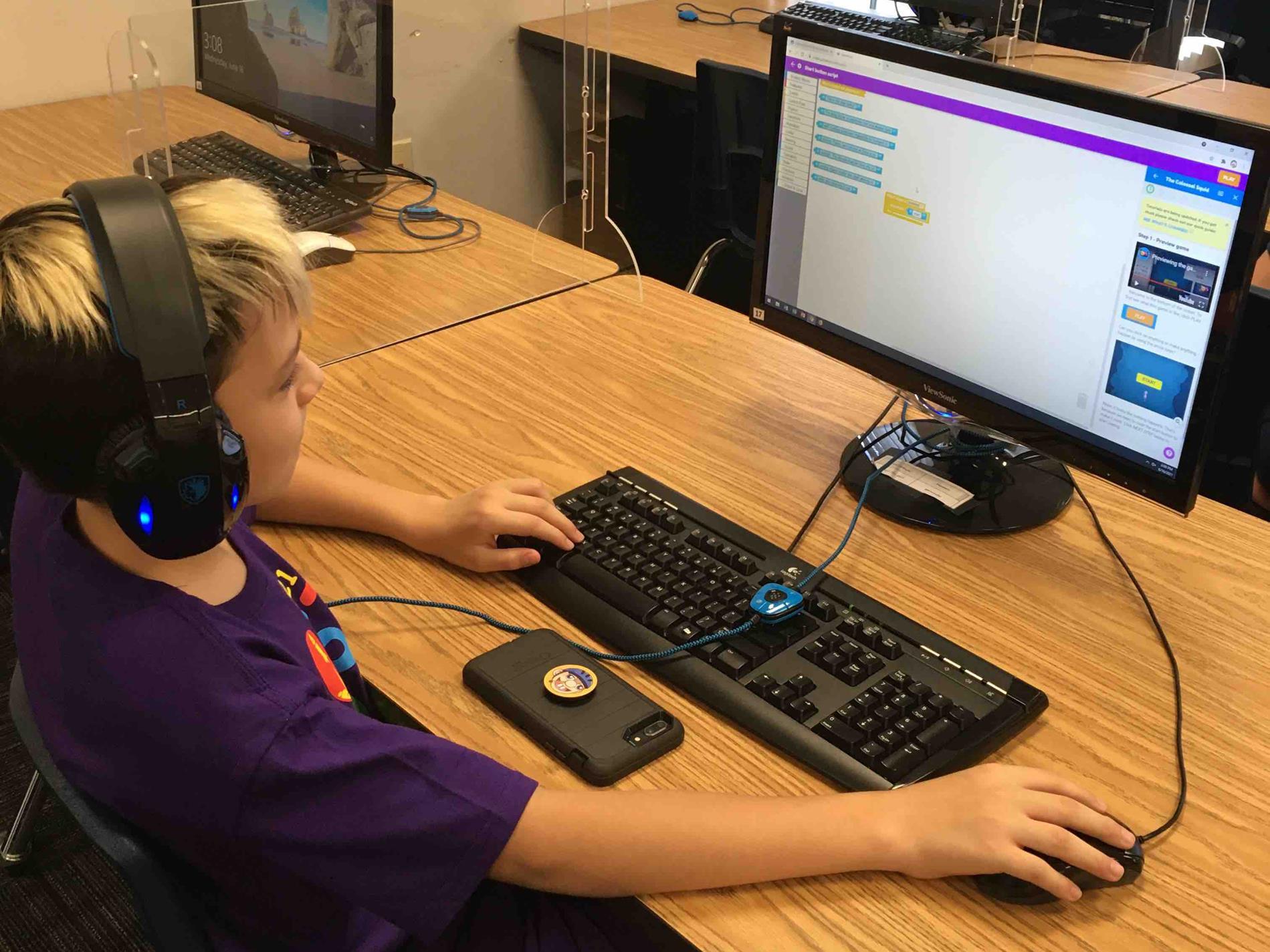 boy works on coding at STEM Academy