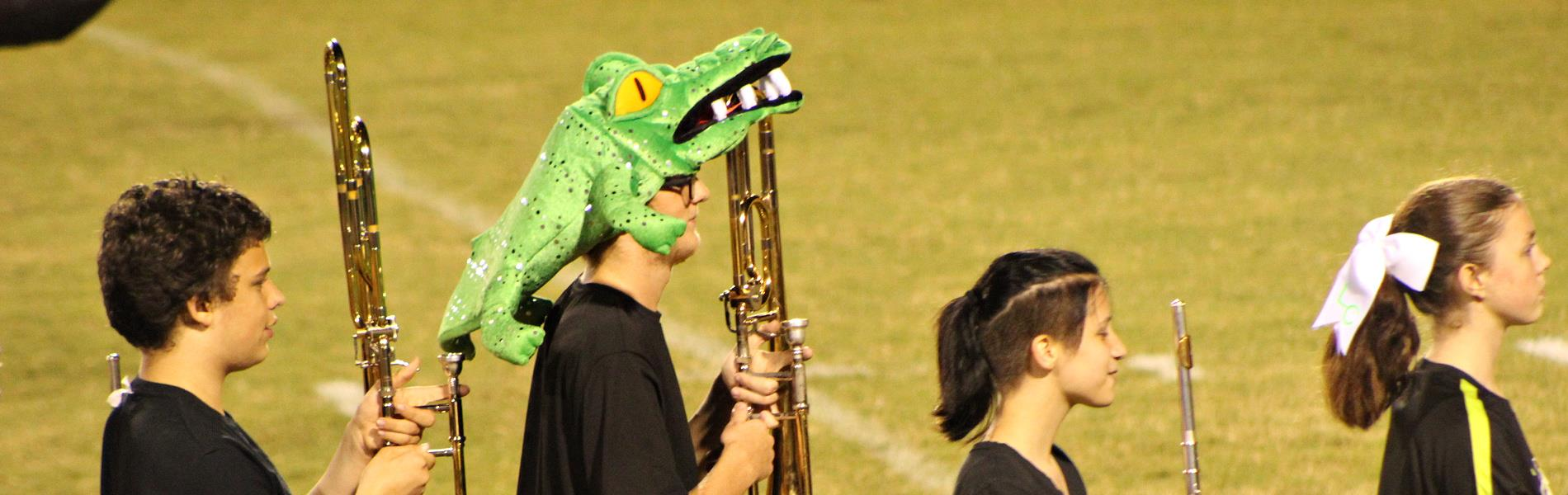 trombone player with gator hat