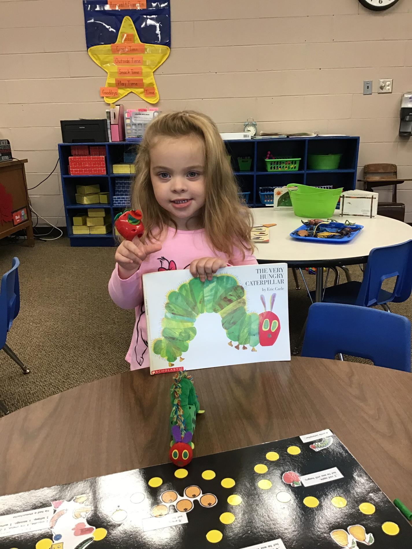 girl holding art