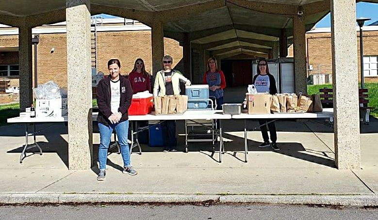 Teachers Handing Out Food