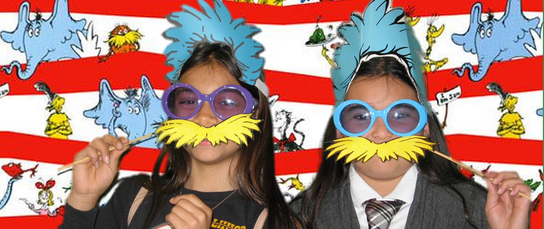picture of girls with dr. seuss masks