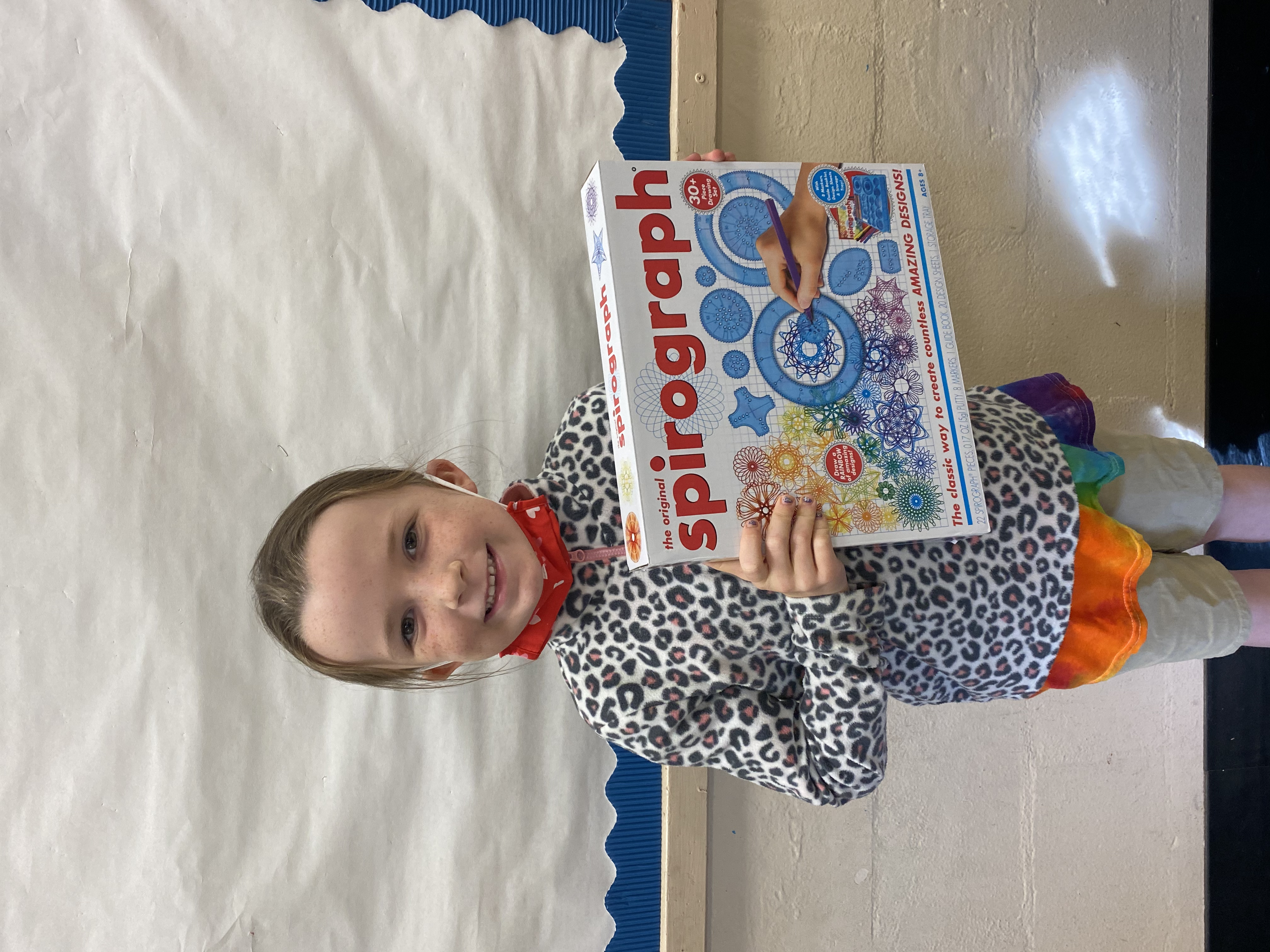 A student holding the Spirograph they won.