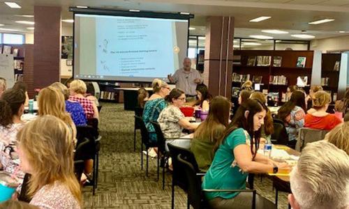 teachers attend professional development class at LHHS library