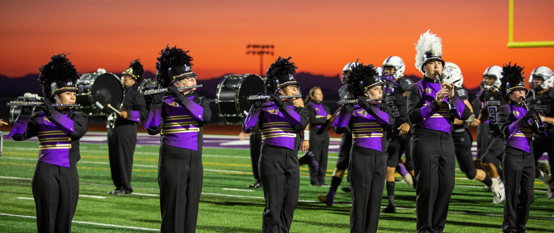 picture of the LHHS Marching Band playing at halftime