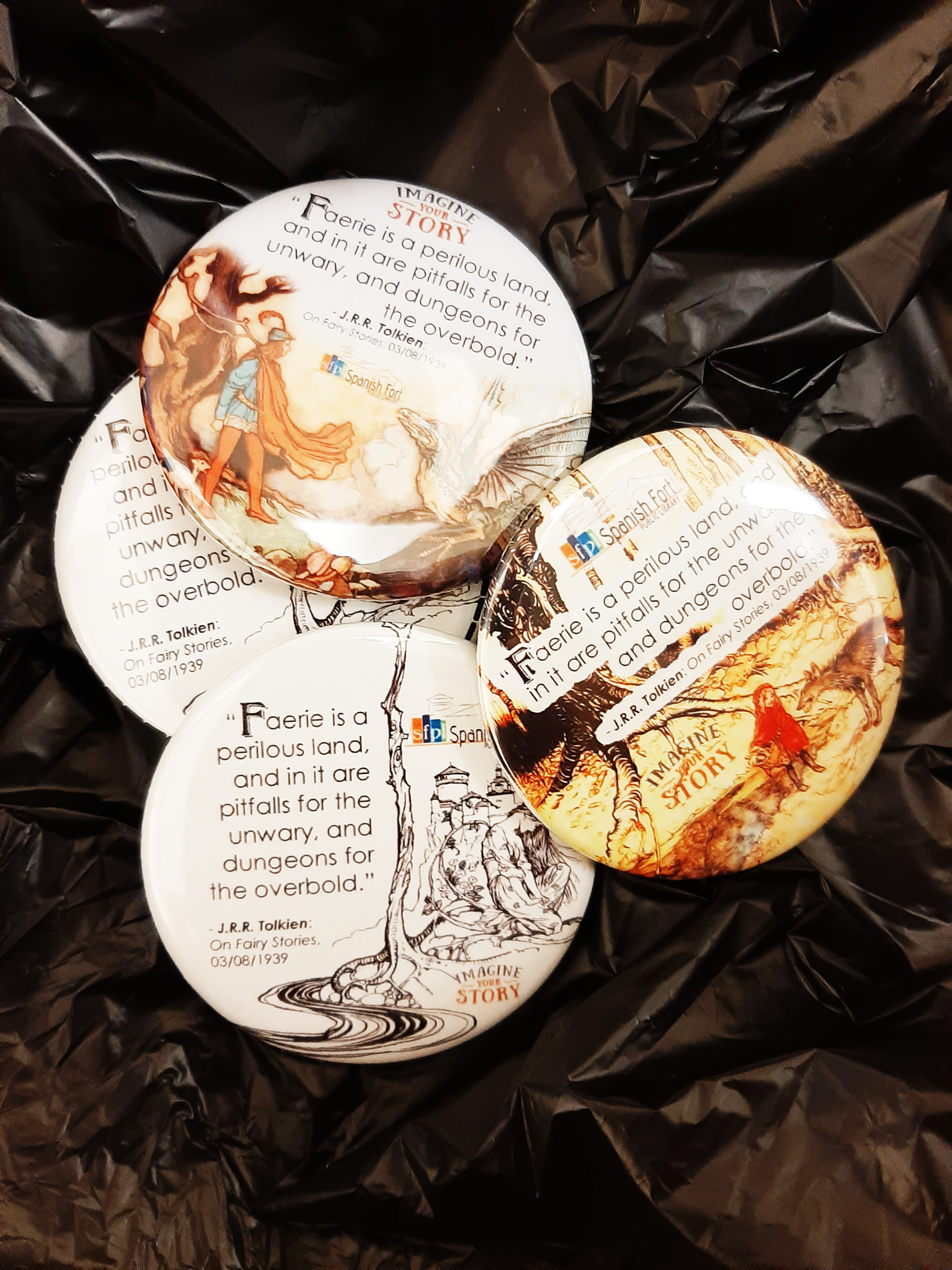 photo of a variety of button pins that can be won by participating in the Grown up Faerie tale Challenge