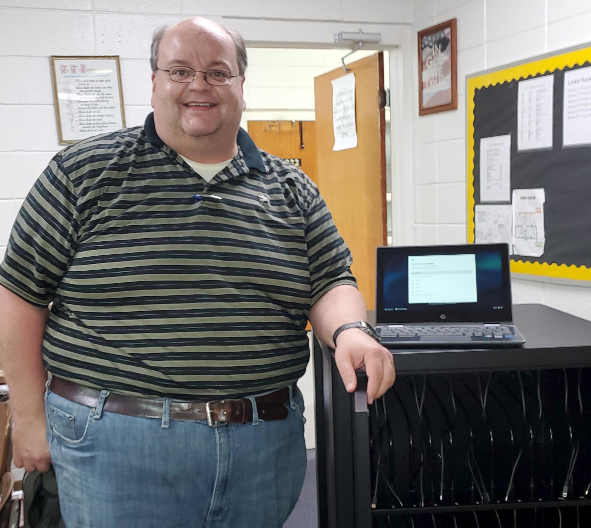Mr. Warnock with new chromebook cart.