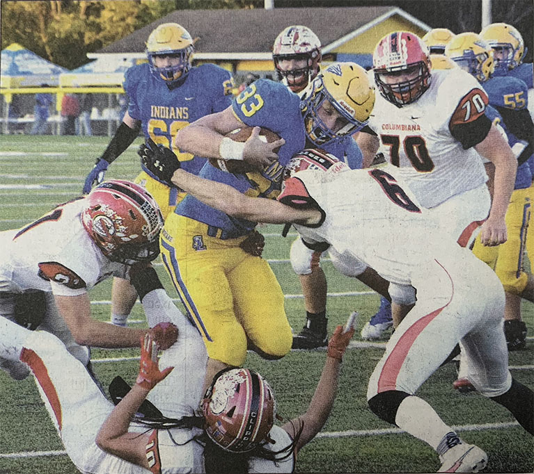 Southern fullback Hunter Morris plows into Columbiana defenders (picture Morning Journal/Ron Firth)