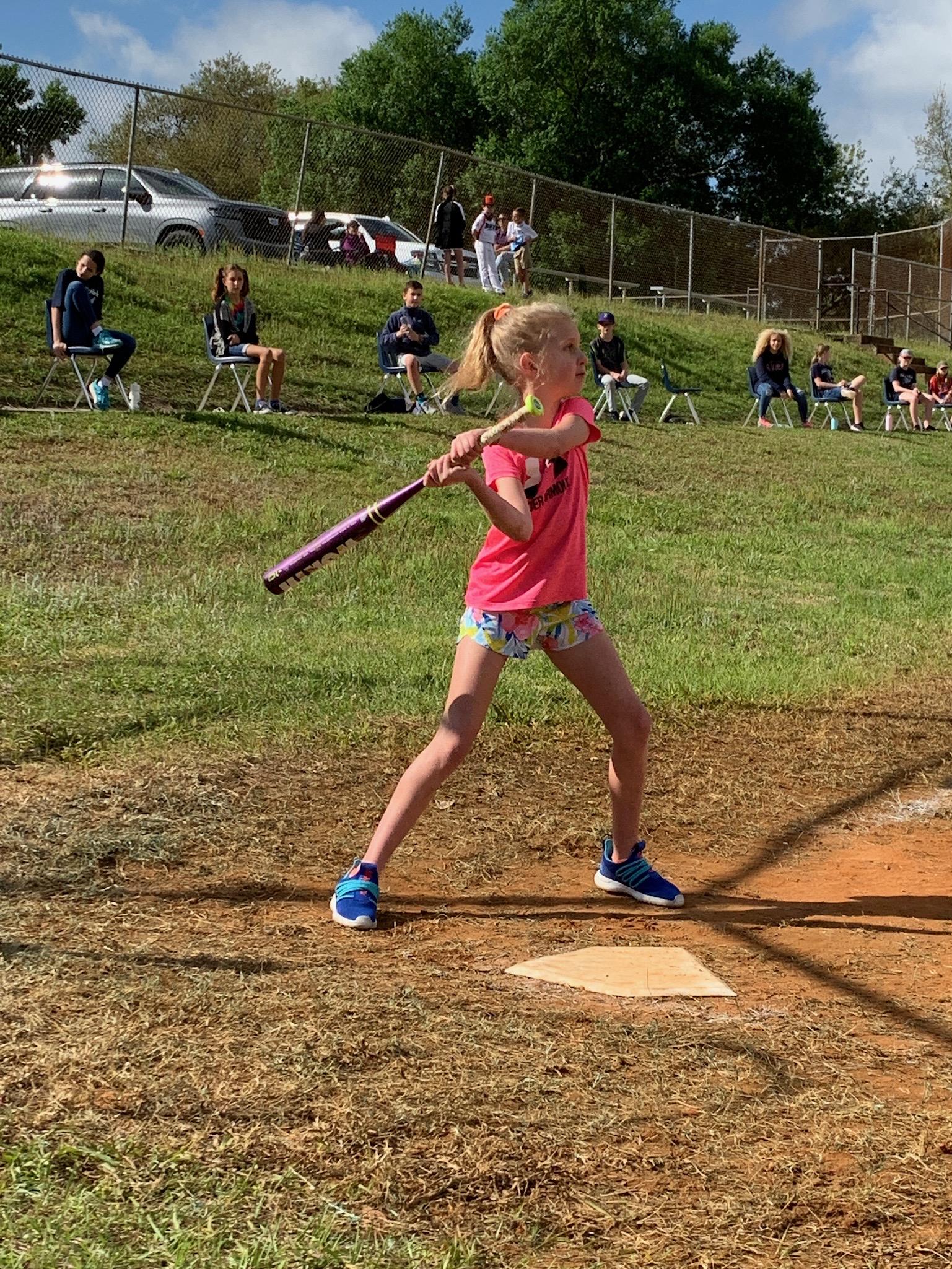 A 5th grade student batting.