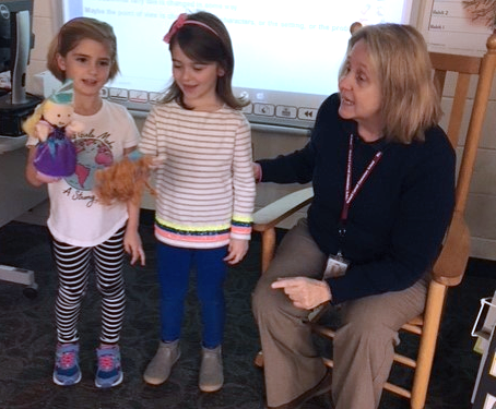 Jane Anne McCormack and Loralei Templeton use puppets to practice reciting nursery rhymes.