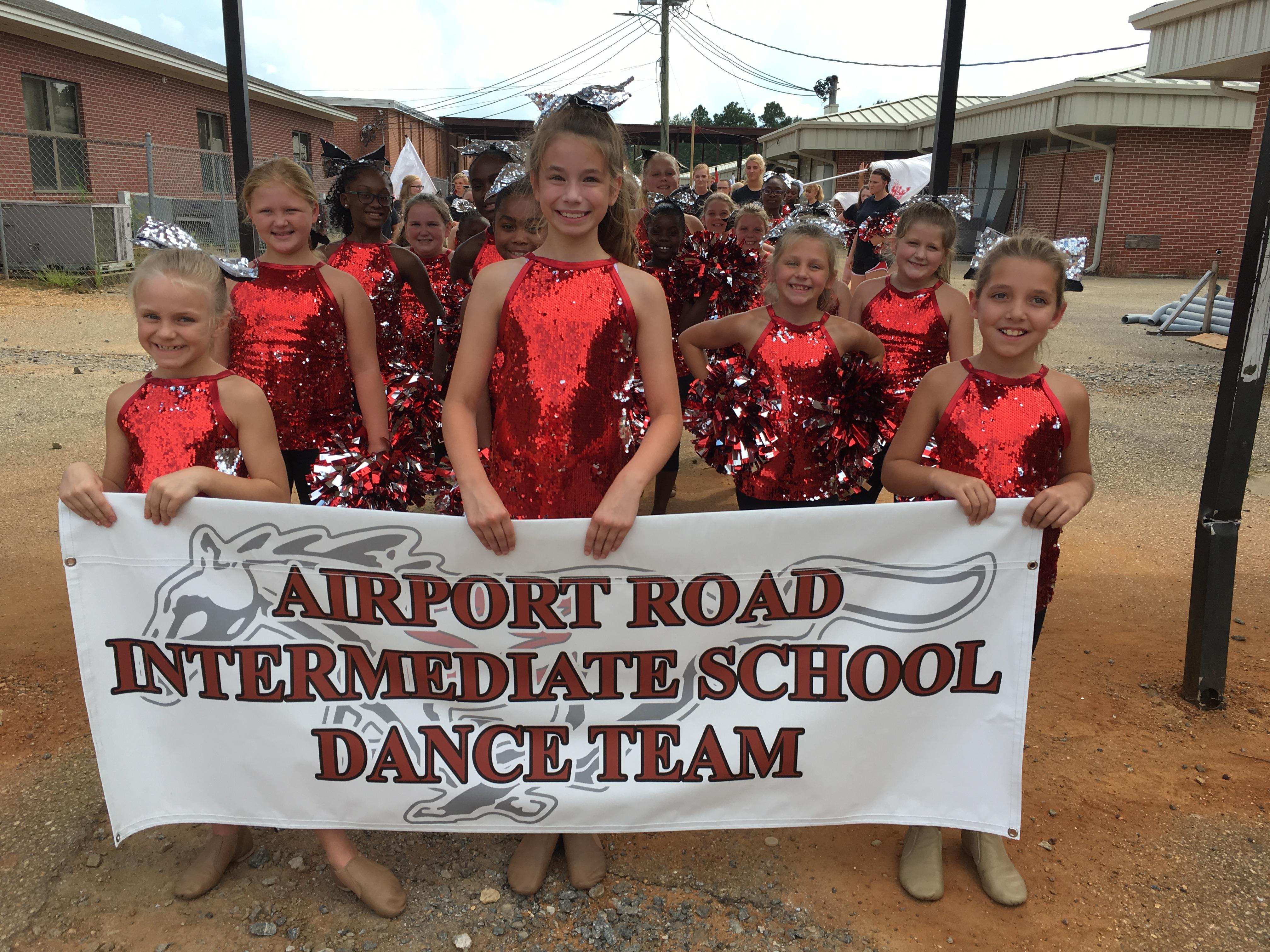 Dance team holding sign