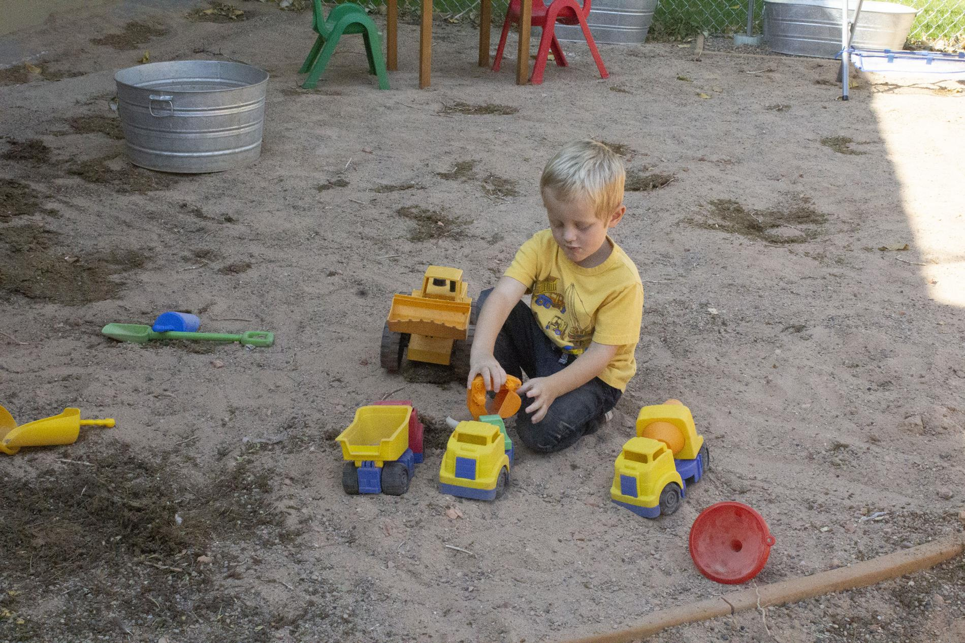 preschool kid playing with toys