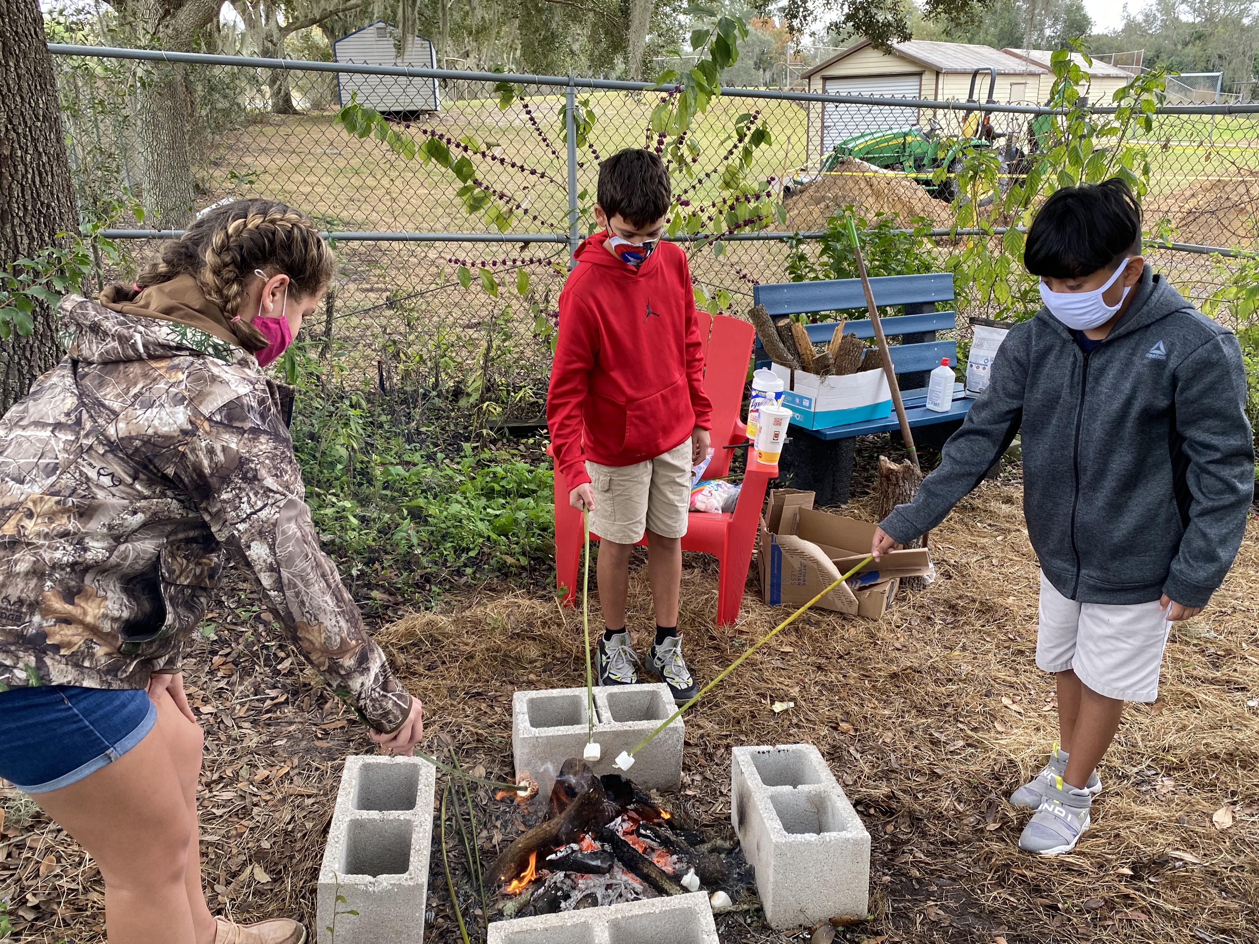 Students roasting marshmallows